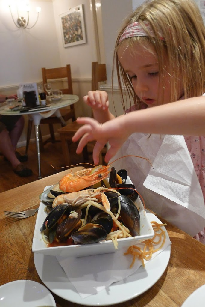 Young Children Eating Seafood Pasta