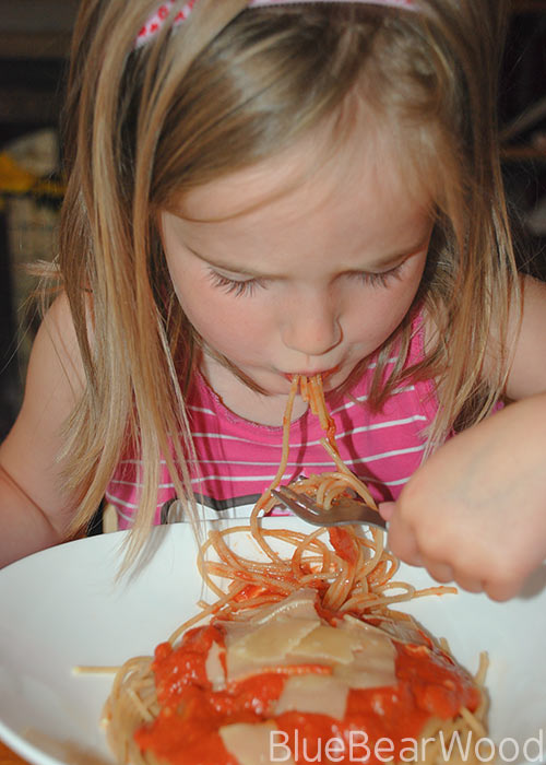 Peanut Butter Tomato Sauce Spaghetti Being Eaten By A Child
