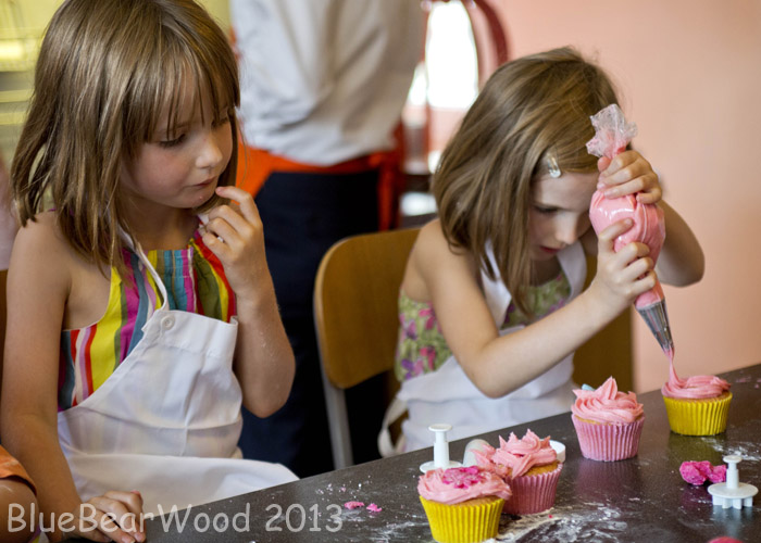 Children Decorating Cakes With Cupcakes And Sprinkles