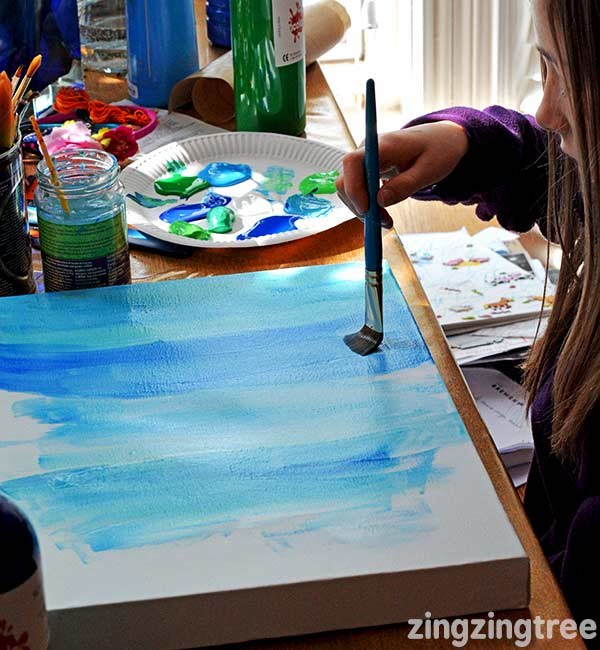 Painting the sea using a mix of blues and greens