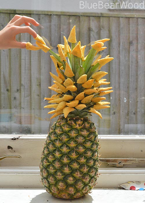 Use Walkers Bugles to decorate the top of a pineapple