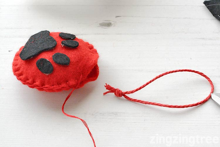 Make the hanging loop for your Felt Paw Print Christmas Tree decoration