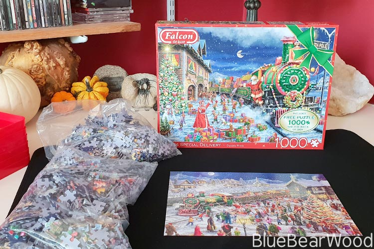 The Falcon de Luxe Santa's Special Delivery Jigsaw Puzzle contents which are two bags of the two Christmassy puzzles