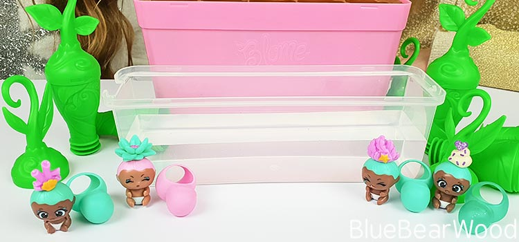 BaBies without Blankets Sitting Next To Lid Filled With Water